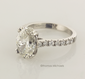 3.00ct. oval cut diaond solitaire with diamond accents .75 view, copyrighted original from Thomas Michaels Designers, Inc.