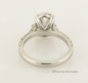 3.00ct. oval cut diaond solitaire with diamond accents back view, copyrighted original from Thomas Michaels Designers, Inc.