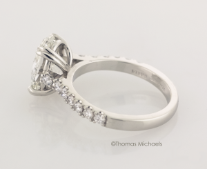 3.00ct. oval cut diaond solitaire with diamond accents side view, copyrighted original from Thomas Michaels Designers, Inc.