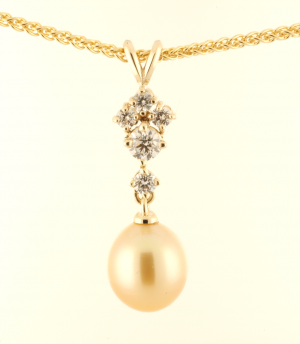 South Sea Baroque, Golden South pearl Pendant in 14KT yellow gold with .40ct. diamond accents on a 14KT yellow gold wheat chain