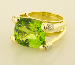 28ct. cushion cut peridot ring with diamond pavé accents 3/4 view