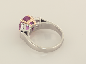 Pink sapphire 4.50ct. and 1.25ct. trapezoid diamonds three stone platinum and 18KT rose gold ring, back