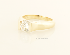 Modern Round Diamond Solitaire in Yellow Gold Side View