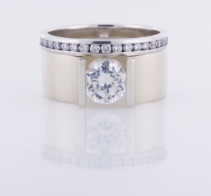 Soitaire RIng with 1.00ct. diamond with an eternity band