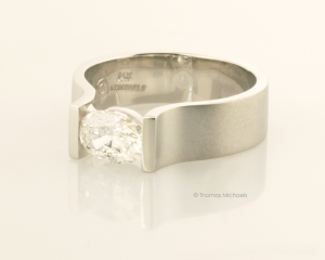Modern Oval Diamond Solitaire in White Gold Side View