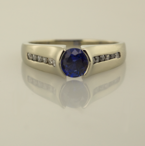 Contemporary Sapphire Solitaire with accent diamonds
