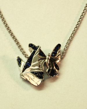 18KT and sapphire (1.50ct.) butterfly motif pendant