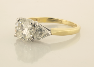 Three Stone Diamond Ring in White and Yellow Gold