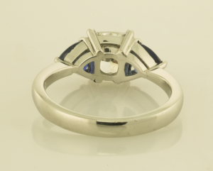 Platinum cushion cut diamond and trillion sapphire ring back view