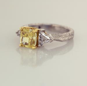 Platinum, 18KTyellow, natural fancy yellow radiant cut diamond, trillian sides