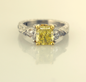 Platinum, 18KTyellow, natural fancy yellow radiant cut diamond, trillian sides