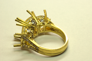 18KT yellow gold mounting with accent diamond set , back view