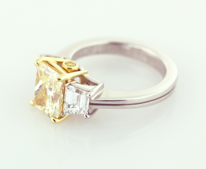 Yellow radiant diamond with side baguettes set in 18KT gold