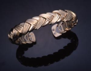 14KT yellow gold flexible braided chevron cuff bracelet , titanium inner spring
