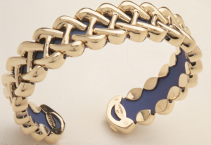 18KT yellow gold and titanium flexible Celtic braid medium cuff bracelet.