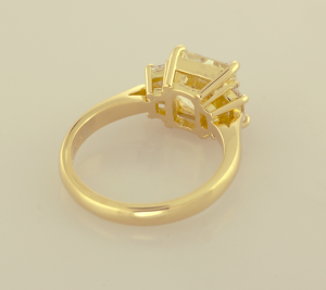 Yellow Diamond, radiant cut with side trapezoid white diamond three stone ring